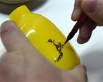 雞油黃鼻煙壺