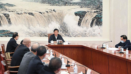 China's top legislator attends symposium with lawmakers