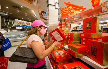 Customers shop for mooncakes ahead of Mid-Autumn Festival in Toronto