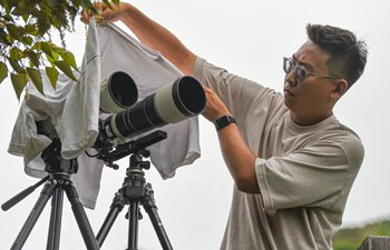 In pics: photography enthusiasts with special interest in astronautics in China's Hainan