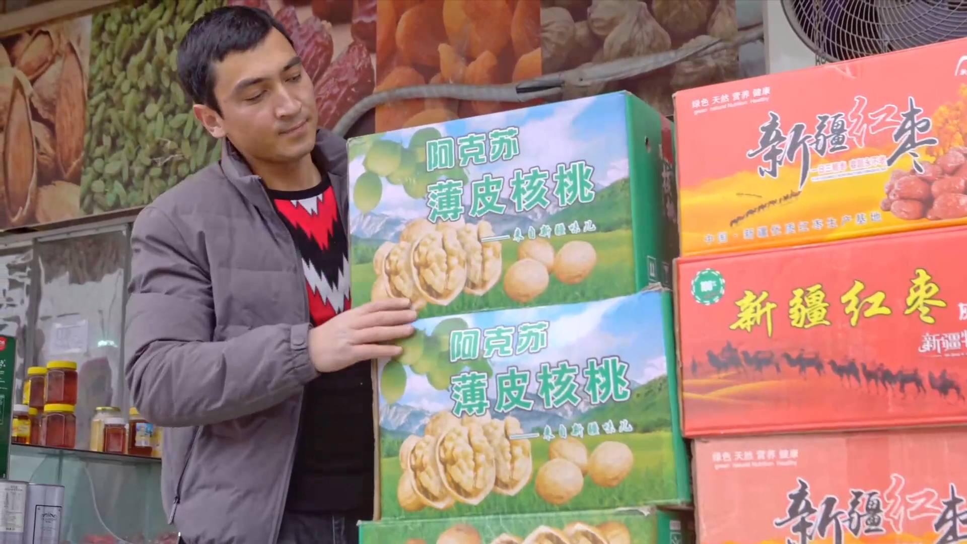 GLOBALink | Xinjiang, My Home: Dried fruit vendors' dreams