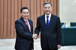 汪洋與老撾建國陣線中央主席賽頌蓬舉行會談
