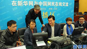 Xinhua reporters cover online interview of Russian PM